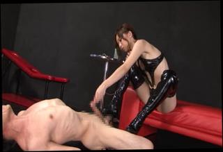 Japanese babe in dominatrix dildo fuck with a serf